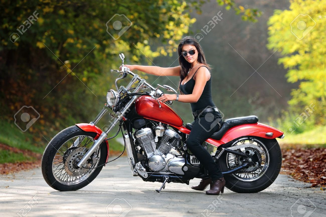 7813143-An-attractive-girl-on-a-motorbike-posing-outside-Stock-Photo-motorcycle-girl-woman